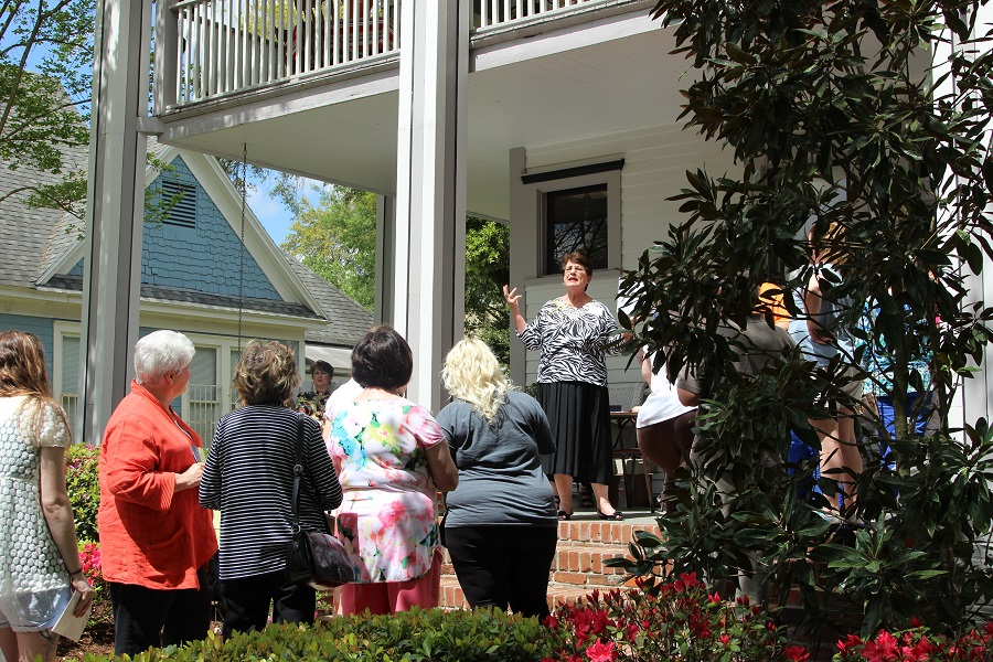 Porch docent Ellie Marquez provides historical background at the Ryder home